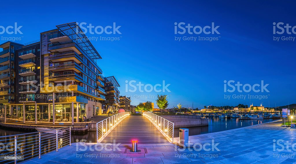 Luxury waterfront apartments restaurants overlooking harbour Aker Brygge Oslo Norway stock photo