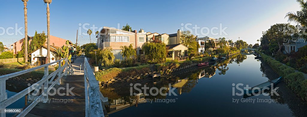 Luxury waterfront homes reflected royalty-free stock photo