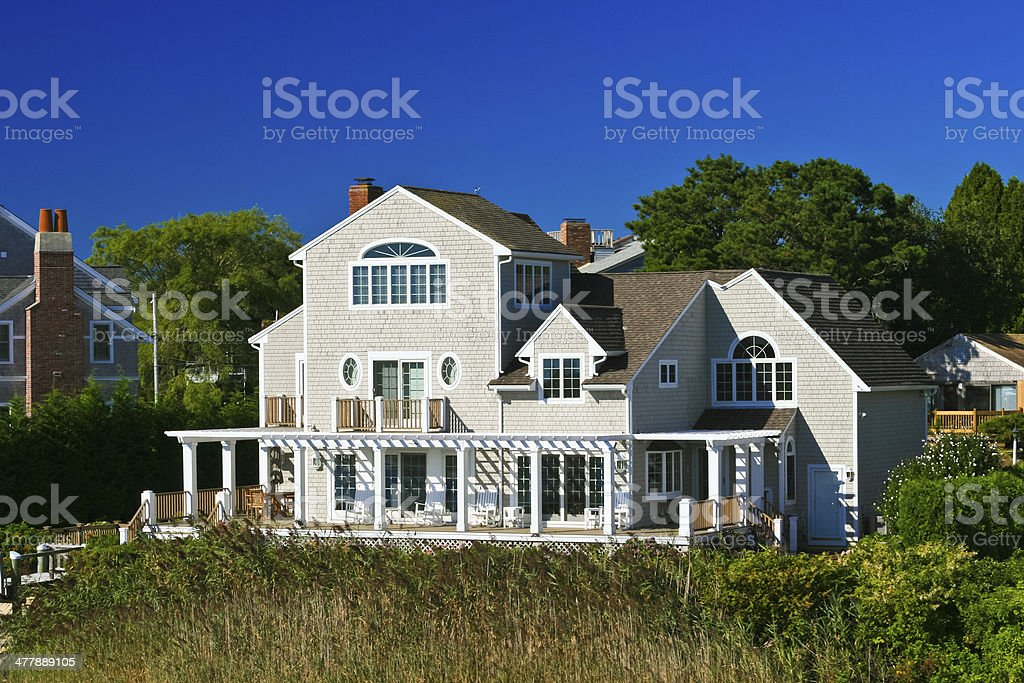 Luxury Waterfront New England House, Hyannis. Blue moning sky. royalty-free stock photo