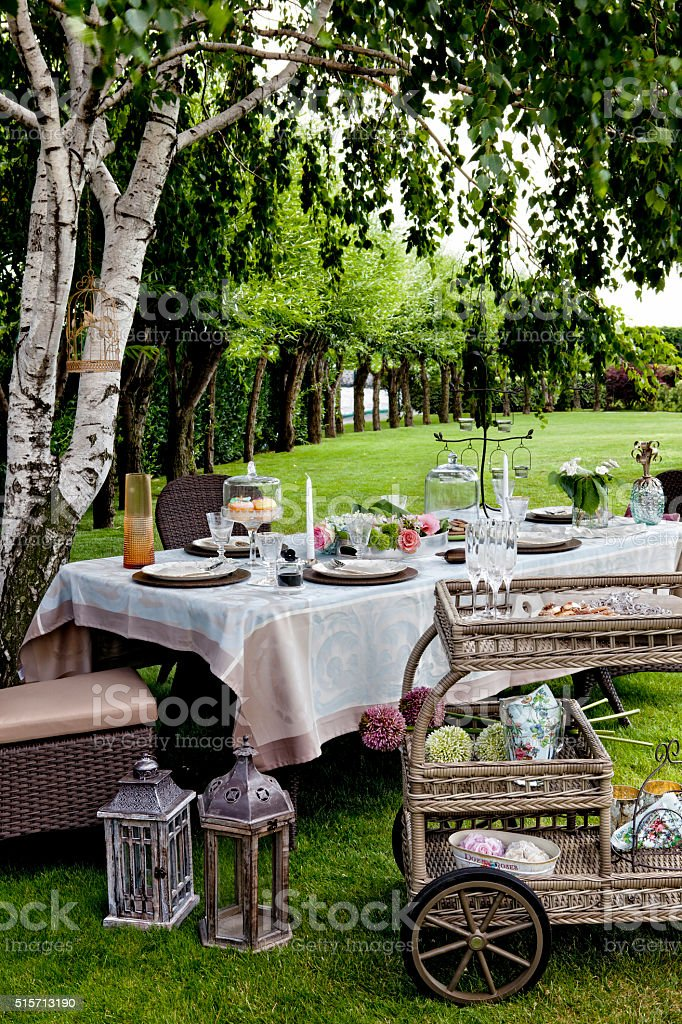 Luxury wedding lunch table setting outdoors stock photo