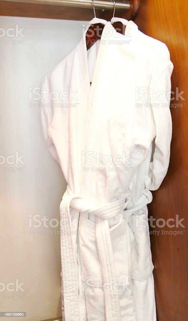 luxury white bathrobes hanging stock photo