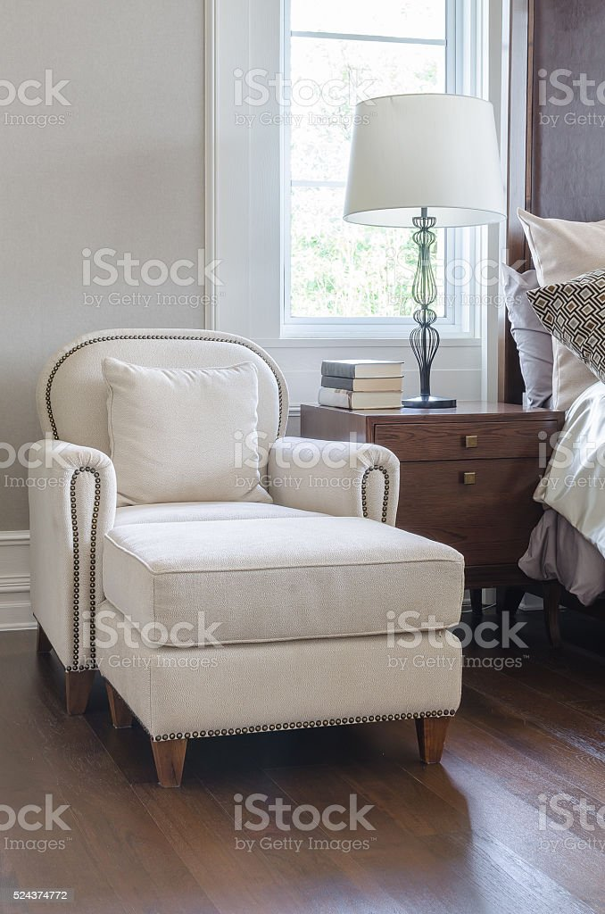 luxury white chair in classic bedroom design stock photo