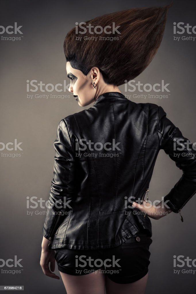 luxury woman with lush hair in leather jacket stock photo