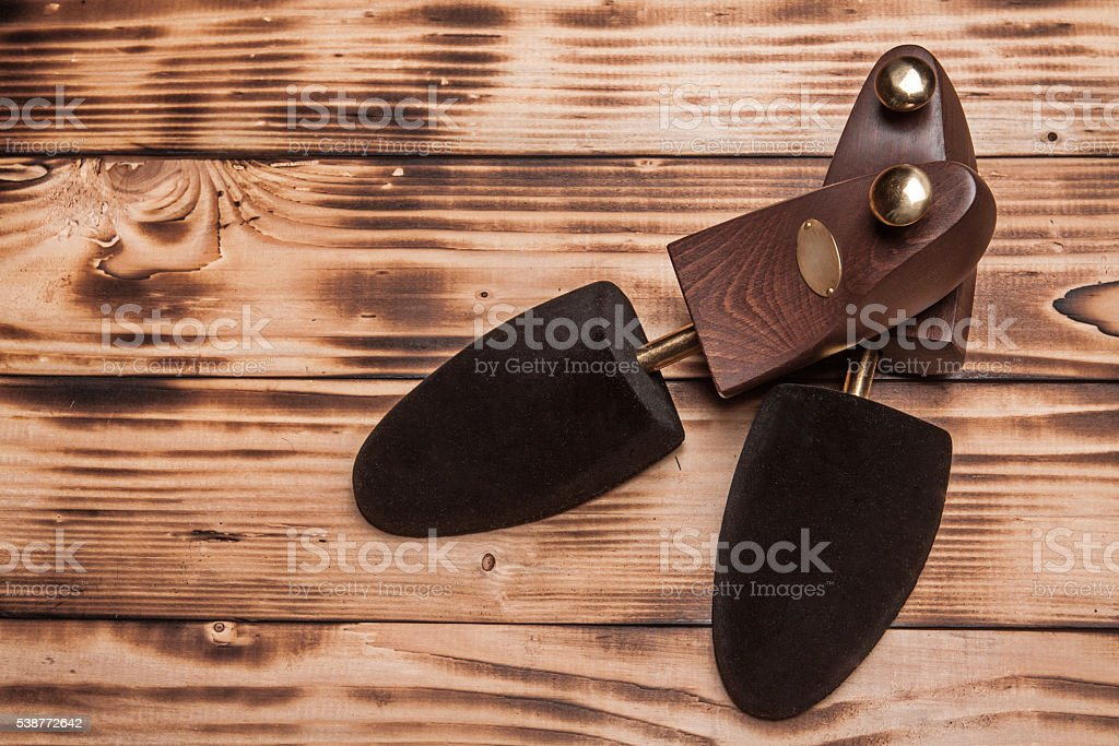 Luxury wooden ceadar shoetree on the vintage textures wooden stock photo