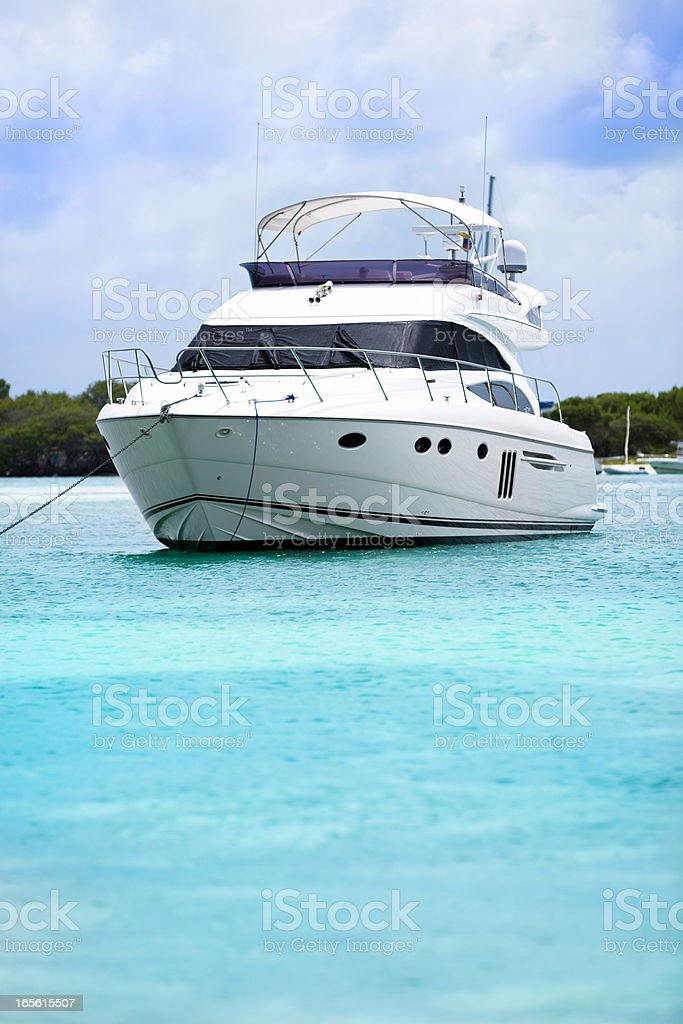 Luxury yacht anchored in a tropical island turquoise beach. royalty-free stock photo