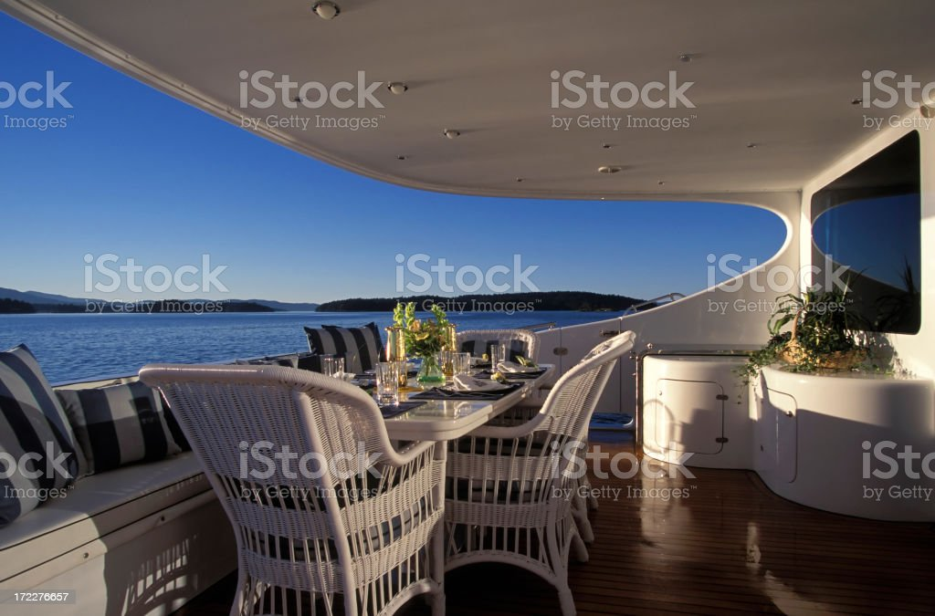 A luxury yacht deck with furniture stock photo