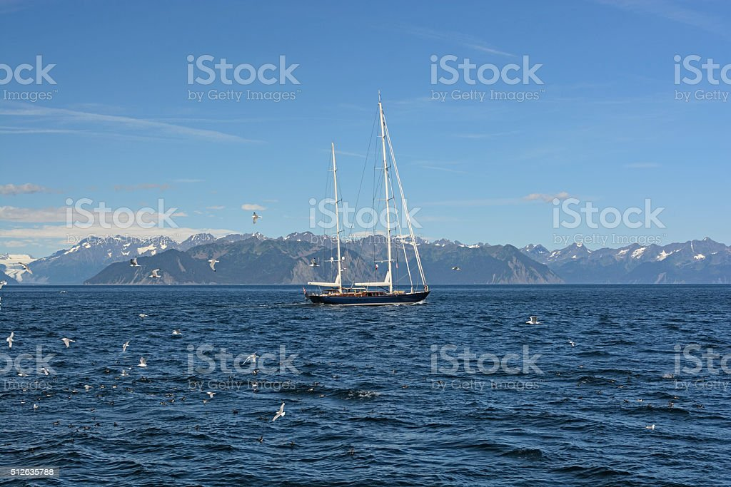 Luxury Yacht Heading out to Sea stock photo