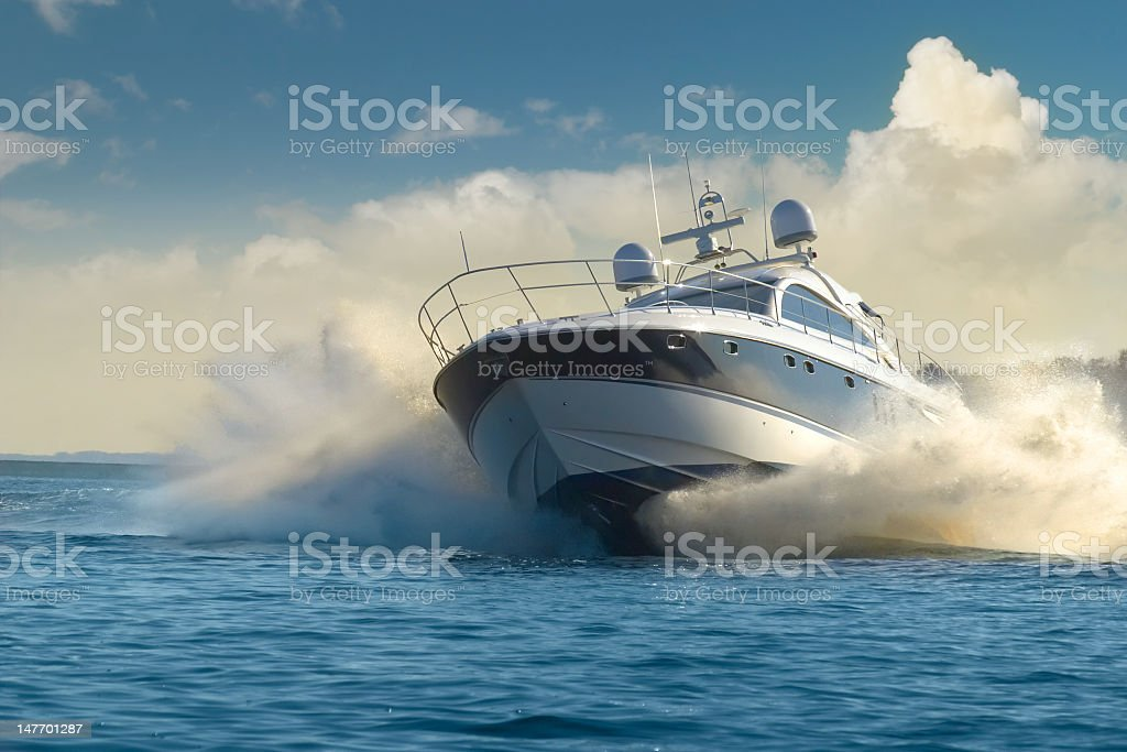 A luxury yacht in motion on the water stock photo