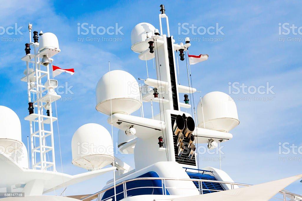 Luxury yacht modern white navigation system against blue sky stock photo