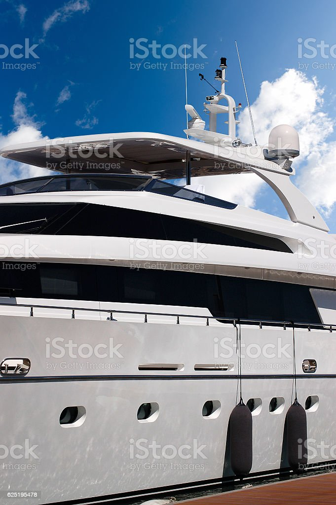 Luxury Yacht on Blue Sky with Clouds stock photo