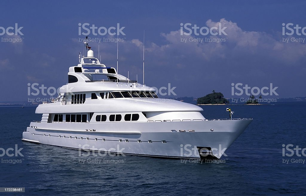 A luxury yacht out in the ocean stock photo