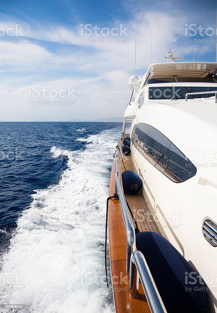Luxury yacht sailing at sea royalty-free stock photo