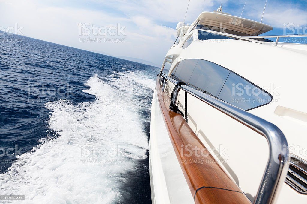 Luxury yacht sailing  at sea with high speed royalty-free stock photo