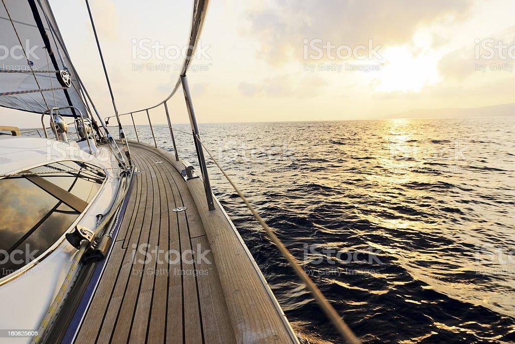 Luxury yacht sailing at sunset stock photo