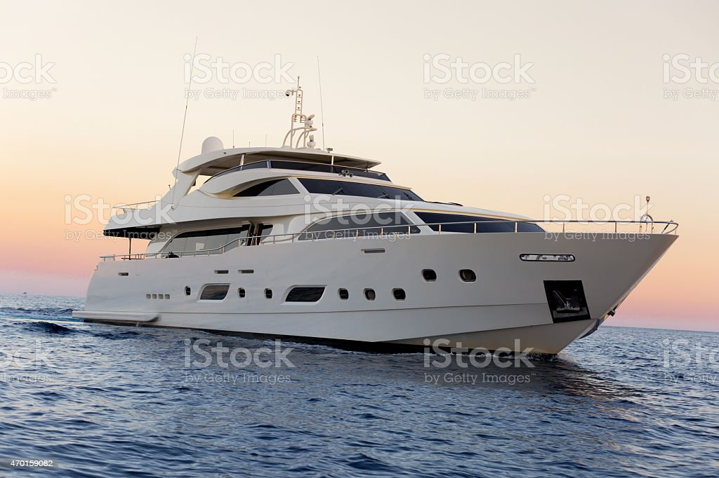 Luxury yacht sailing on the sea sunset stock photo