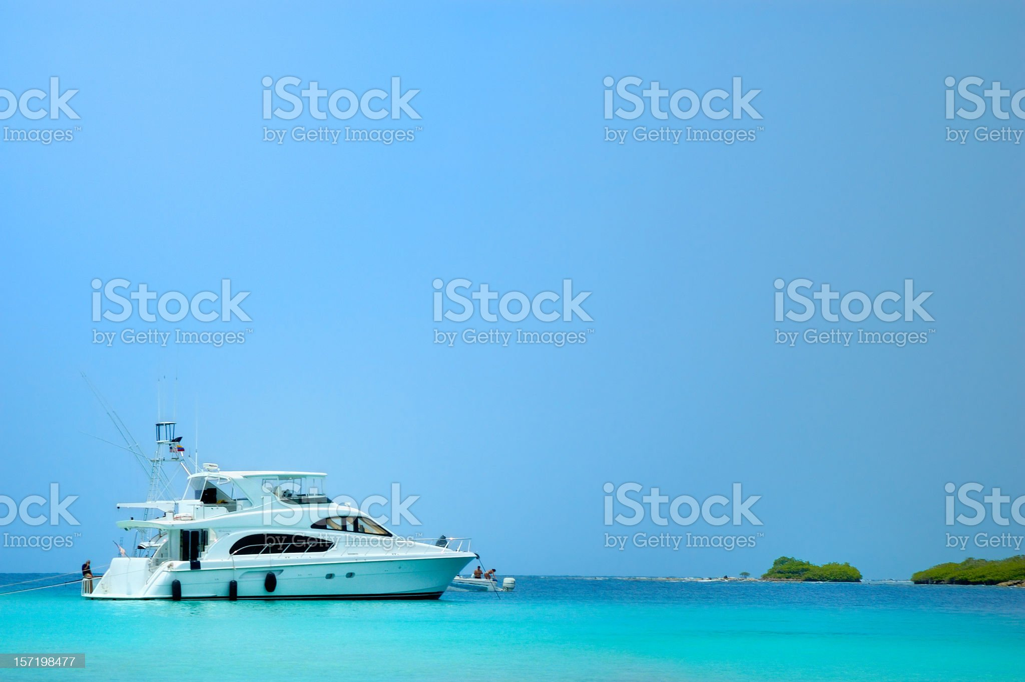 Luxury Yachts anchored in a tropical exotic island beach royalty-free stock photo
