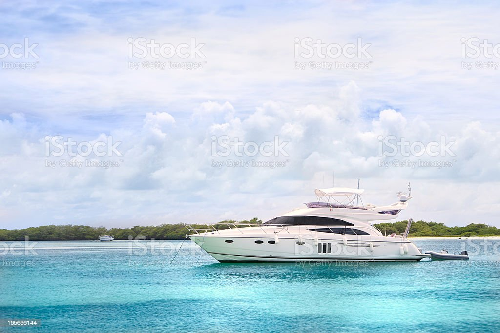 Luxury Yachts anchored in a tropical exotic island beach stock photo
