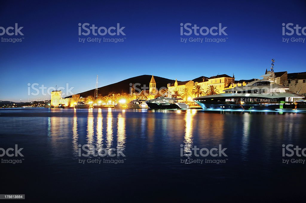 Luxury yachts docked in Trogir at Night stock photo