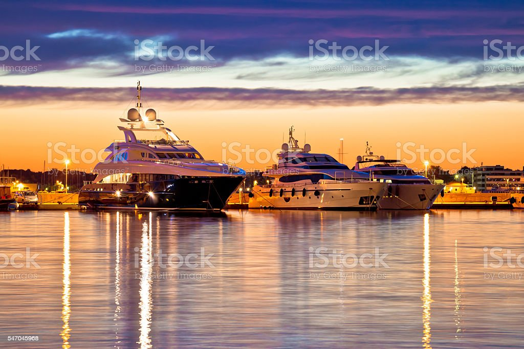 Luxury yachts harbor at golden hour view stock photo