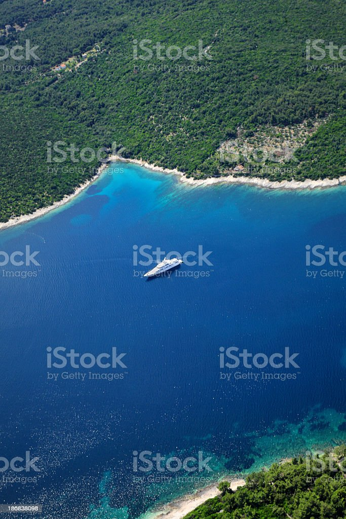 Luxury yachts in beautiful bay royalty-free stock photo