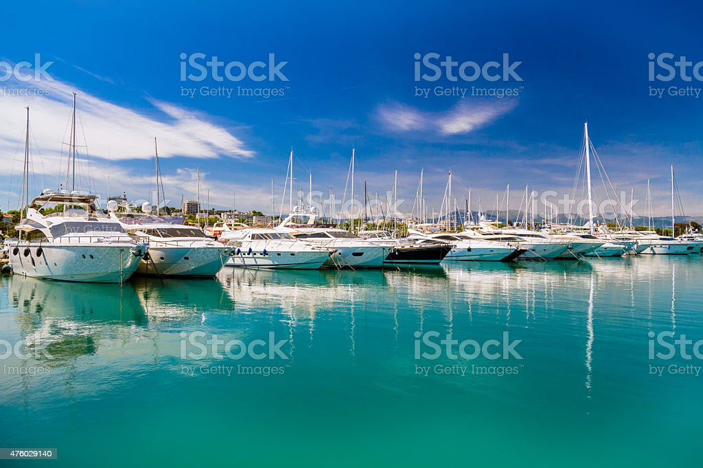 Luxury Yachts in Mediterranean Harbor stock photo