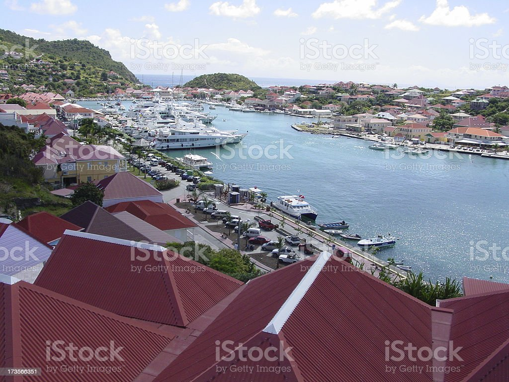 Luxury Yachts in the crowded harbor of Gustavia stock photo