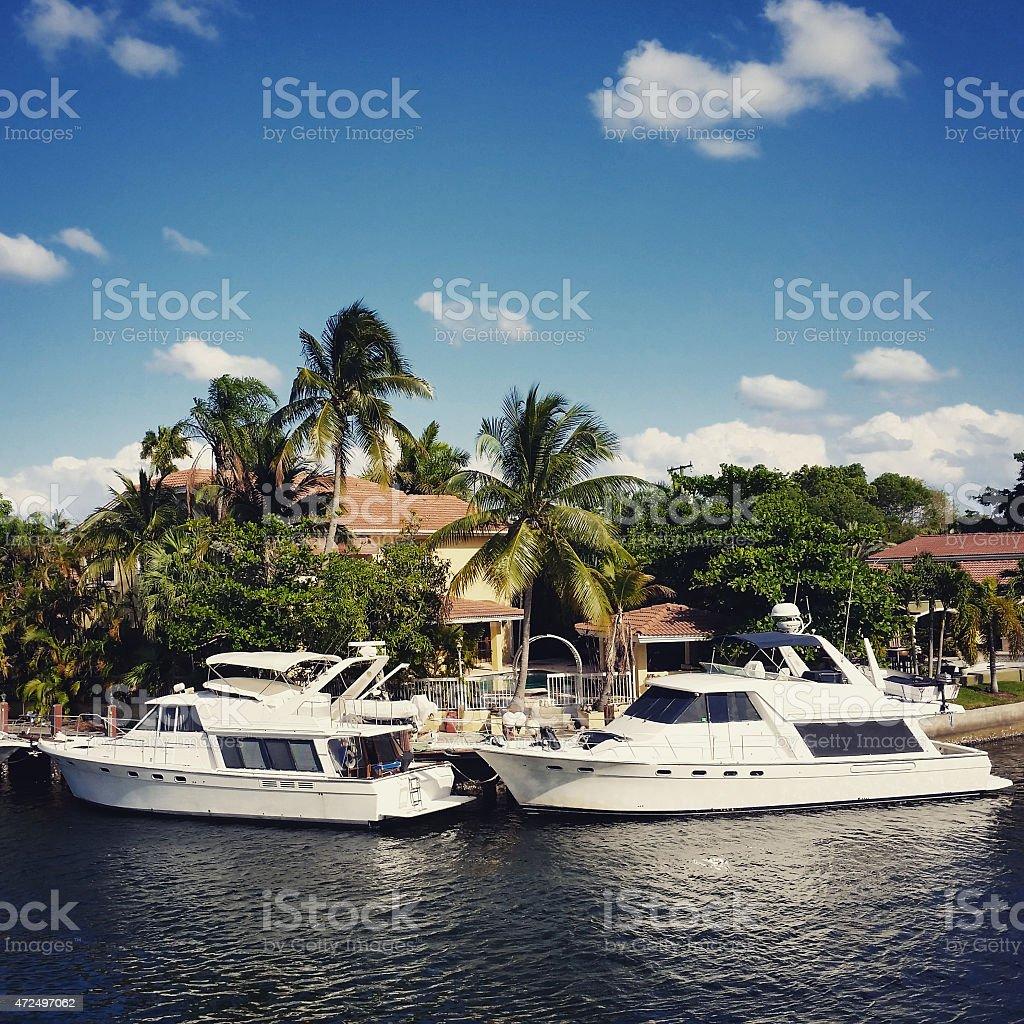Luxury Yachts in Tropical Miami Florida Residential Neighborhood stock photo