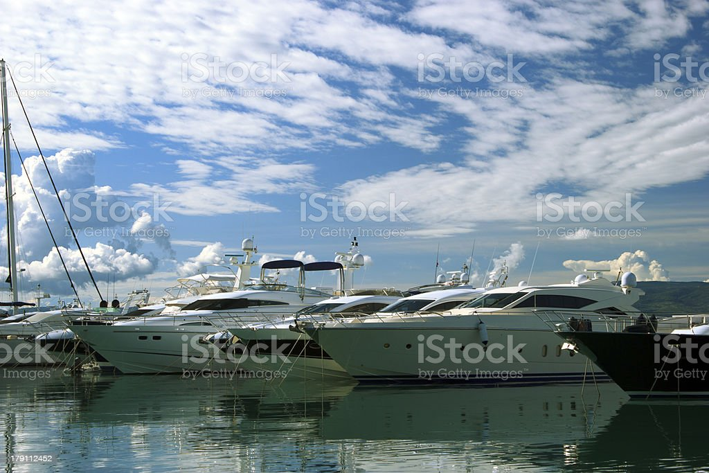 Luxury yachts moored on pier royalty-free stock photo