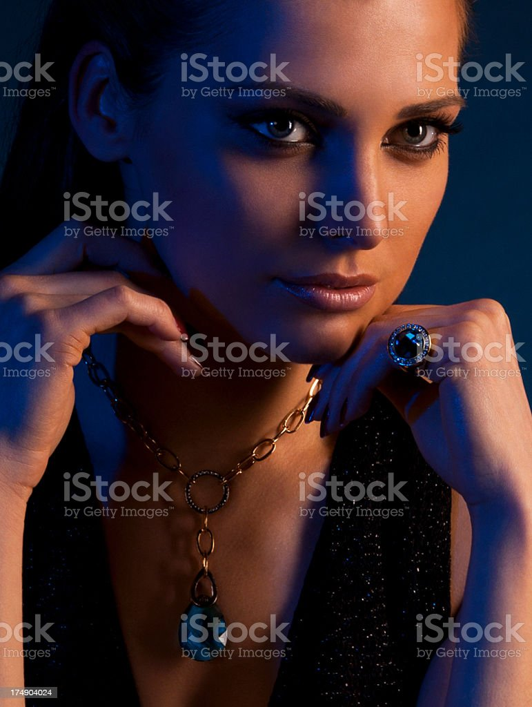 luxury young dark-haired girl in exclusive jewelry stock photo