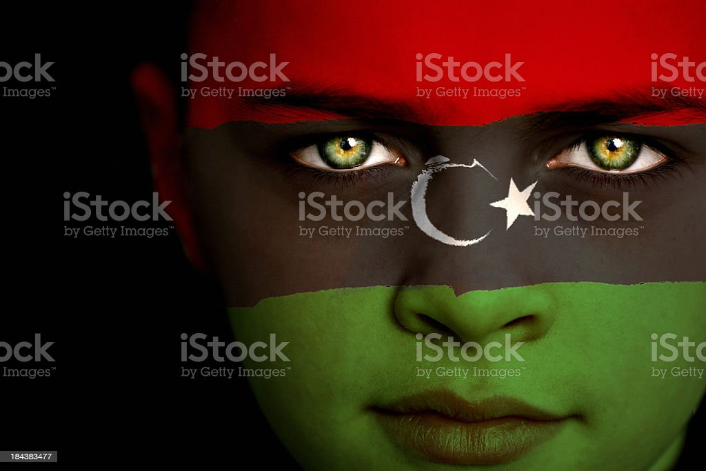 Lybian flag boy stock photo