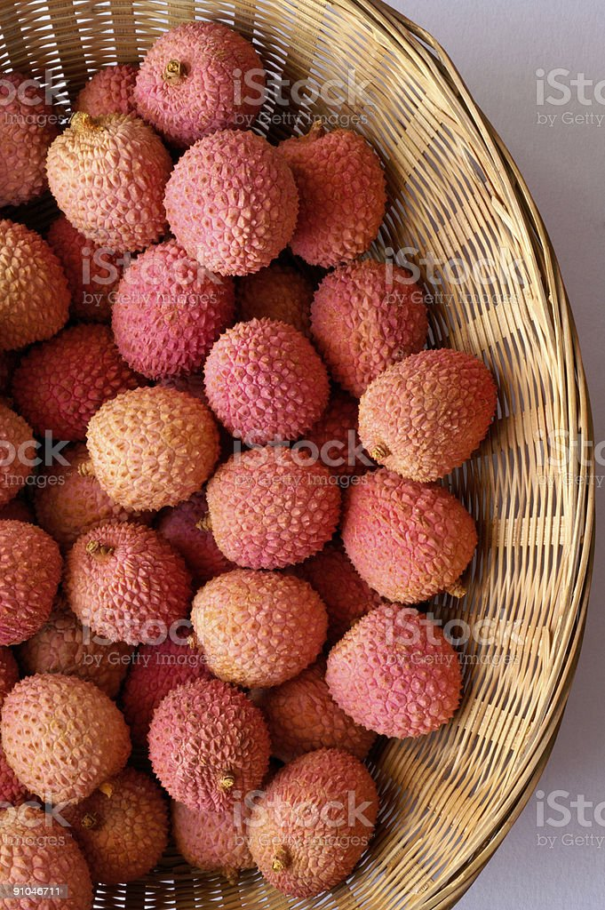Lychee - Litchi chinensis in basket (vertical) royalty-free stock photo