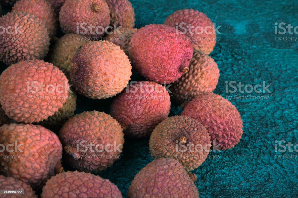 Lychee on a blue cement background stock photo