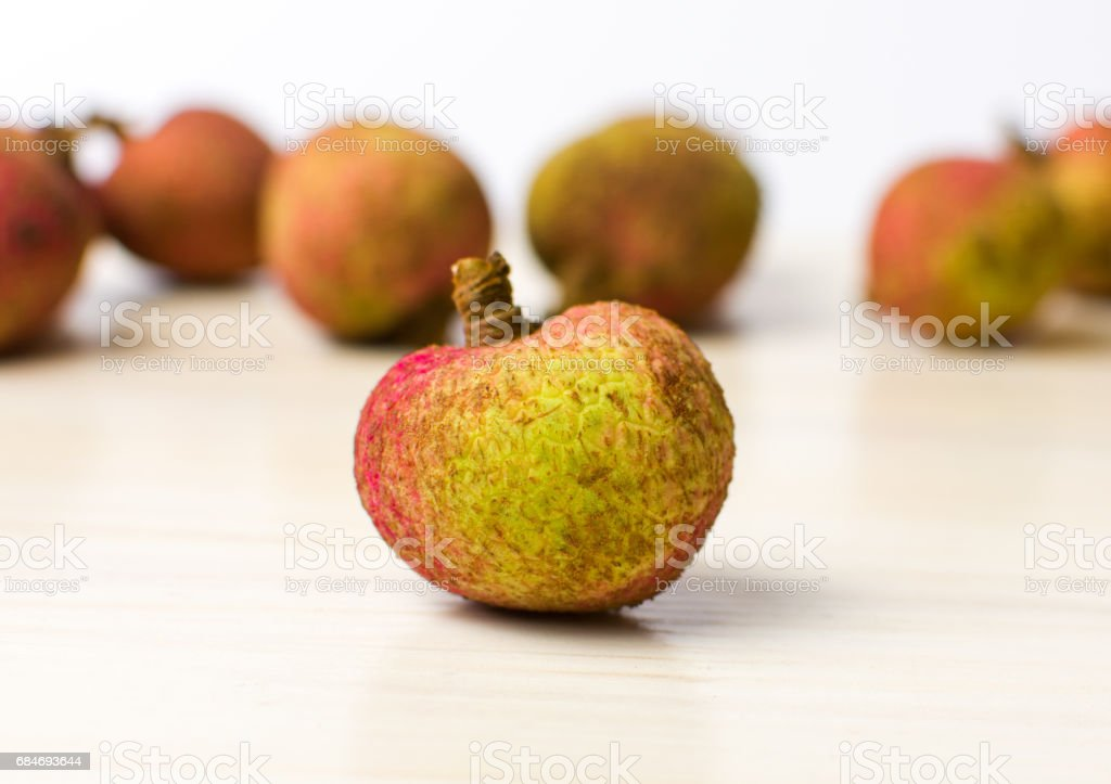 Lychee tropical fruit on wooden table stock photo