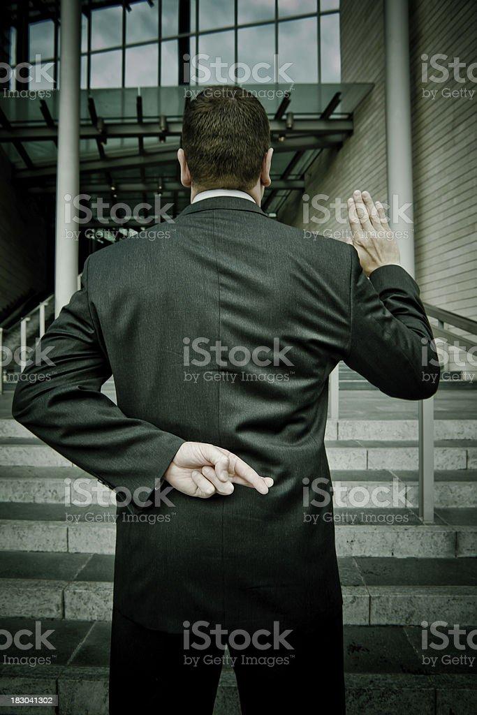 Lying Businessman stock photo