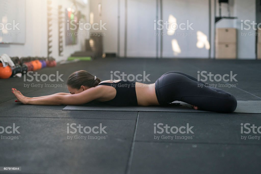 Lying down in lotus stock photo