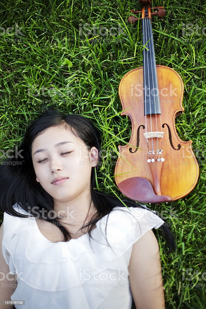 Lying down with her violin stock photo