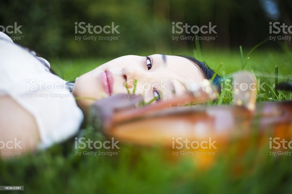 Lying down with her violin royalty-free stock photo