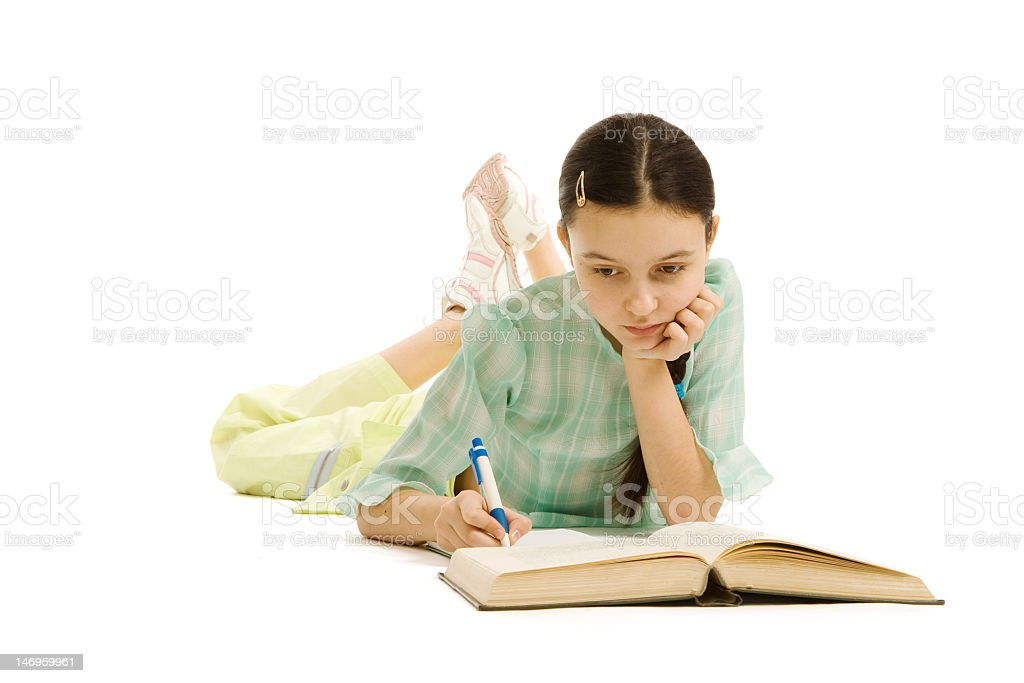 Lying girl copies words from the book royalty-free stock photo