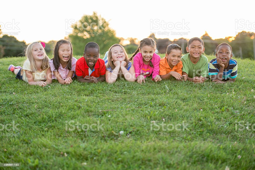 Lying in the Grass Together stock photo