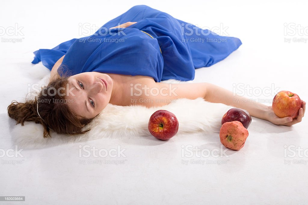 Lying lady with apples royalty-free stock photo