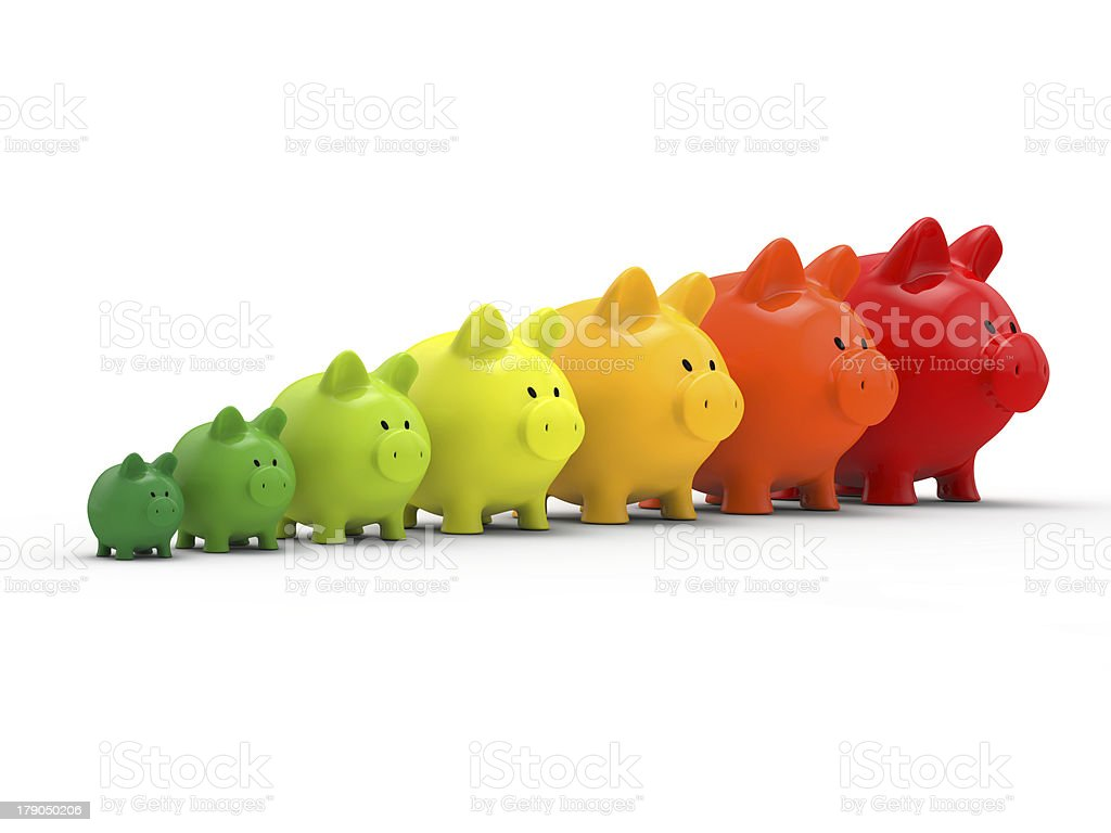 Lying of piggybanks growing in size to show energy-saving stock photo