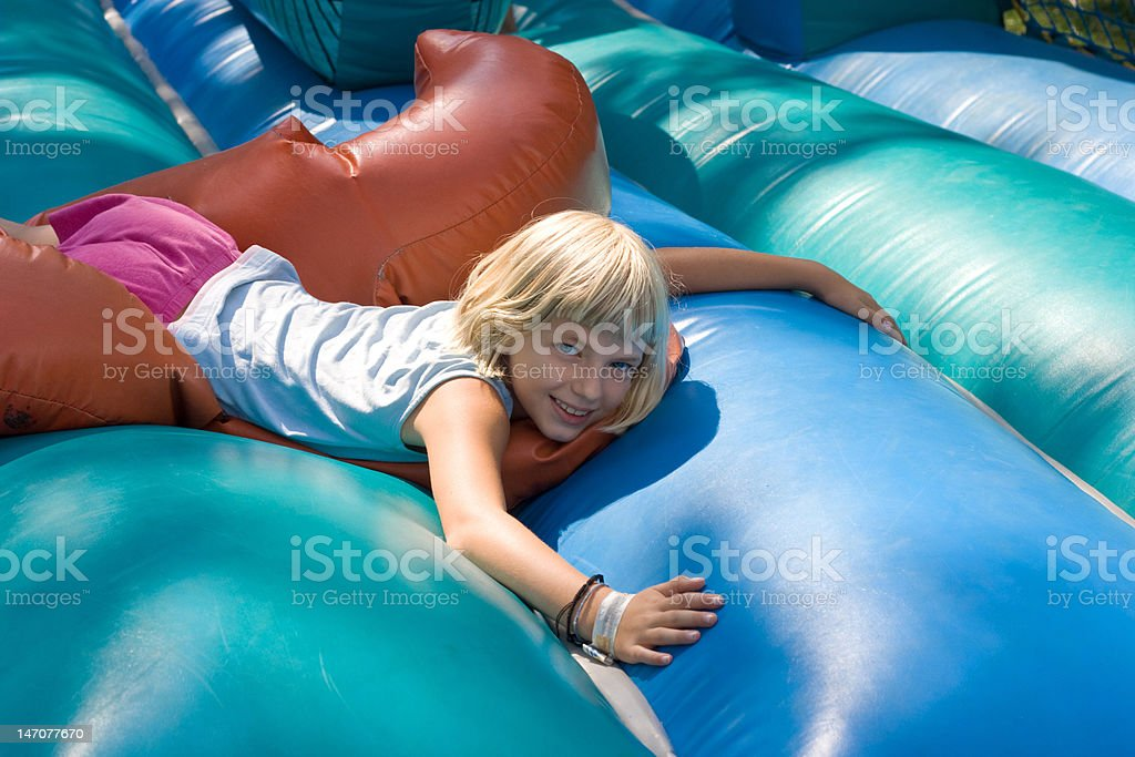 Lying on an inflatable blow-up toy royalty-free stock photo