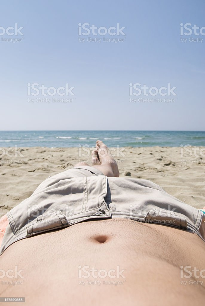 lying on the beach see horizont royalty-free stock photo