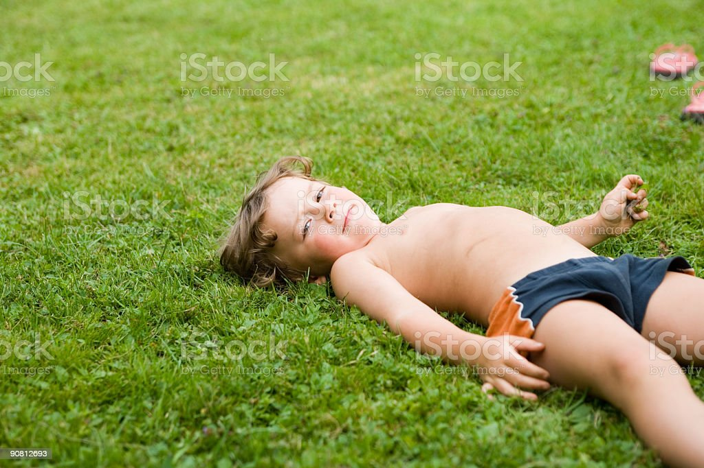 lying on the grass - don't worry royalty-free stock photo
