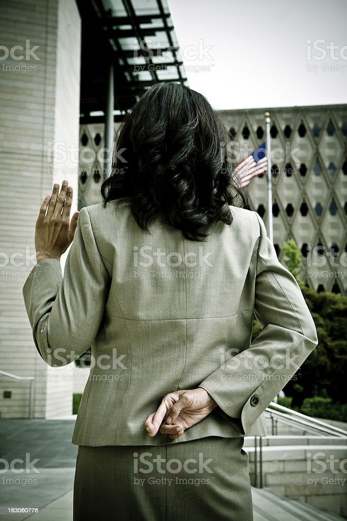 Lying or Committing Perjury in front of the American Flag stock photo