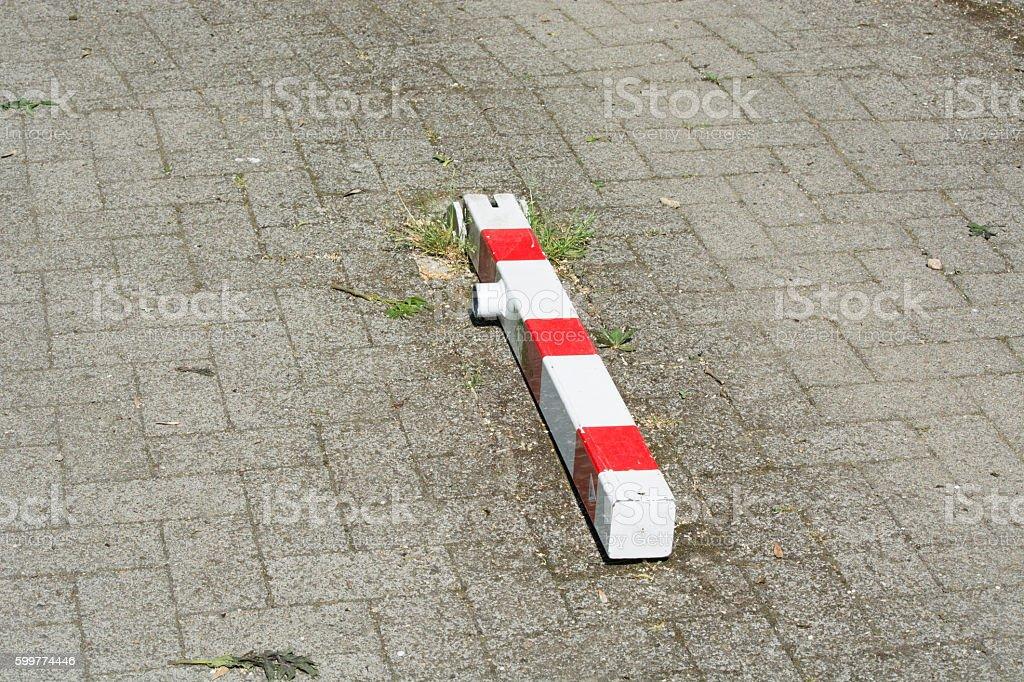 Lying red white striped bollards stock photo