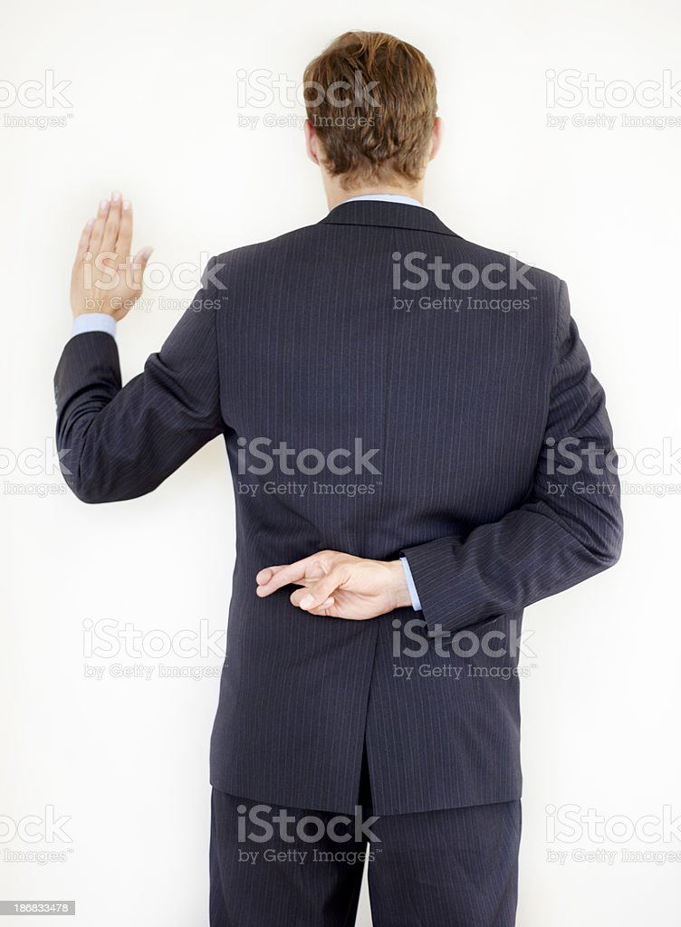 Lying under oath royalty-free stock photo