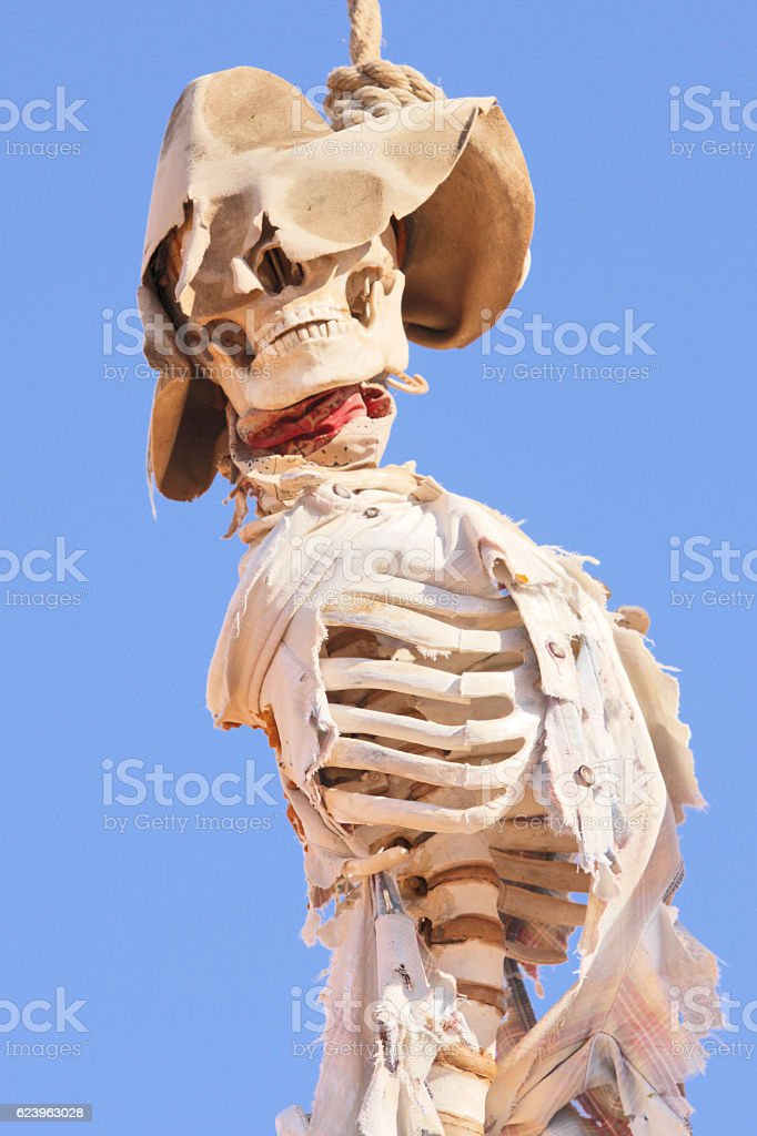 Lynching Cowboy Skeleton Gallows Justice stock photo