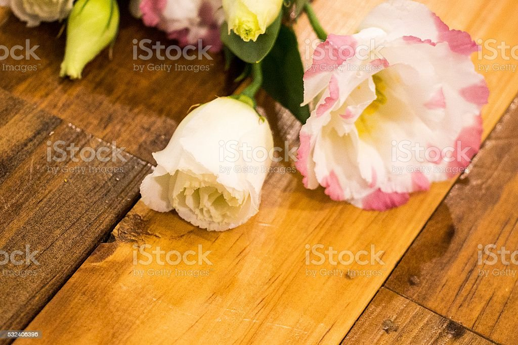 Lysianthus Flower on wooden background stock photo