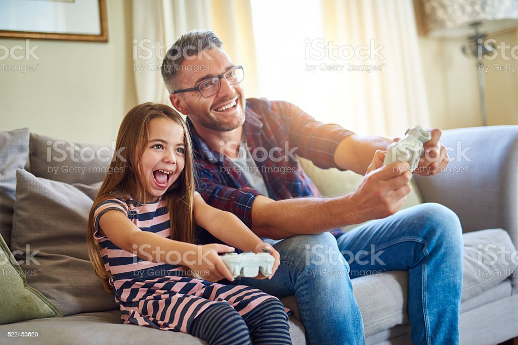 I'm beating you dad! stock photo